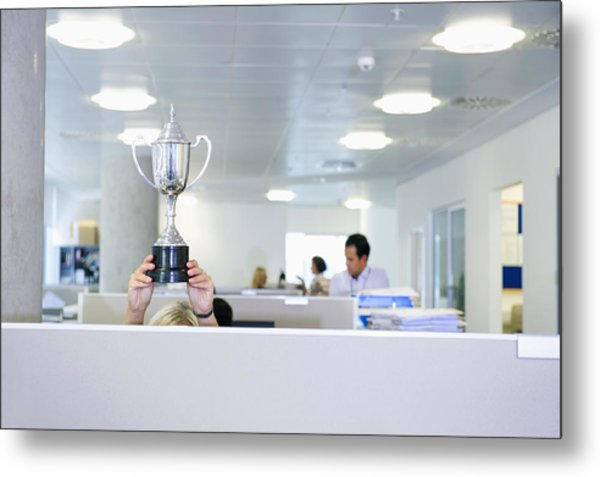 Businesswoman Holding Trophy Over Office Cubicle Metal Print by Jacobs Stock Photography Ltd