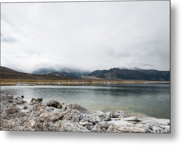 Calm Lake Against Mountain Range Metal Print by Christian Soldatke / EyeEm