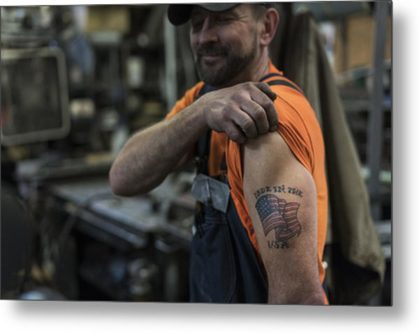Caucasian Worker Displaying Tattoo In Factory Metal Print by Jetta Productions Inc