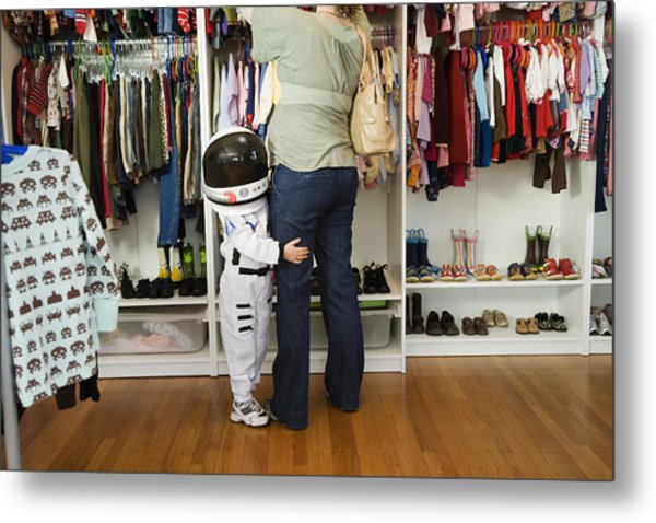 Child (4-5 Yeras) Wearing Space Costume Hugging Mother's Leg In Shop Metal Print by Inti St. Clair