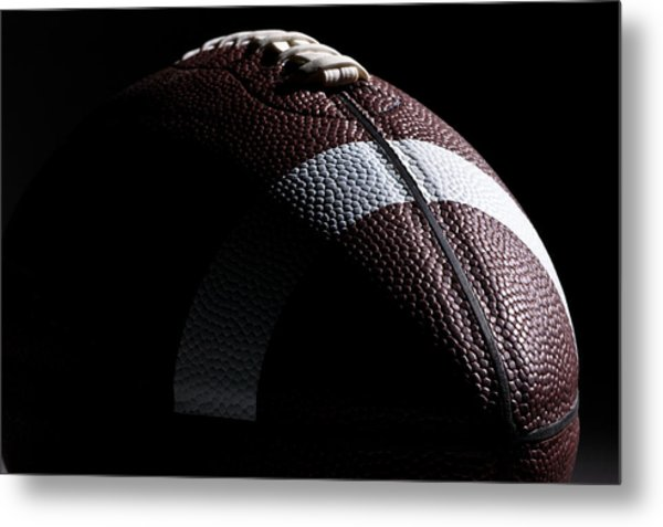 Close-up Of American Football With Dramatic Lighting Metal Print by Kledge