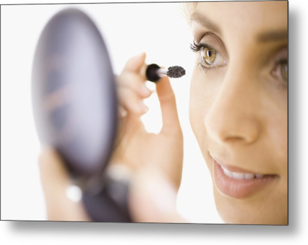 Close-up Of Woman Applying Makeup Metal Print by Jupiterimages, Brand X Pictures
