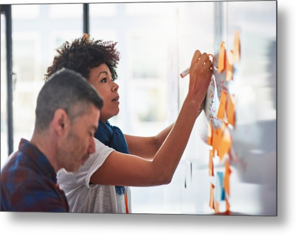 Colleagues Brainstorming In A Tech Start-up Office Metal Print by 10'000 Hours