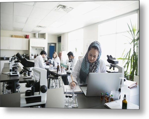 College Student Wearing Hijab At Laptop In Science Laboratory Metal Print by Hero Images