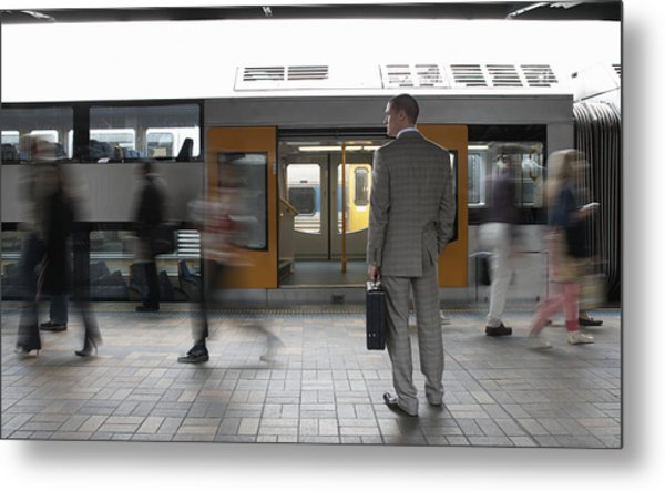 Commuters Passing Businessman On Platform,  (blurred Motion) Metal Print by Toby Burrows