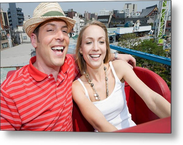 Couple At An Amusement Park Metal Print by Image Source