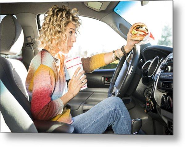 Eating Fast Food Hamburgers And Driving. Metal Print by Jordan Siemens