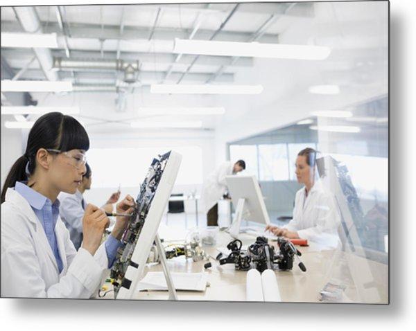 Engineer Assembling Computer Parts Metal Print by Hero Images