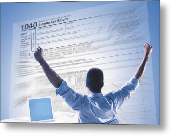 Excited Man And Income Tax Form Metal Print by Comstock
