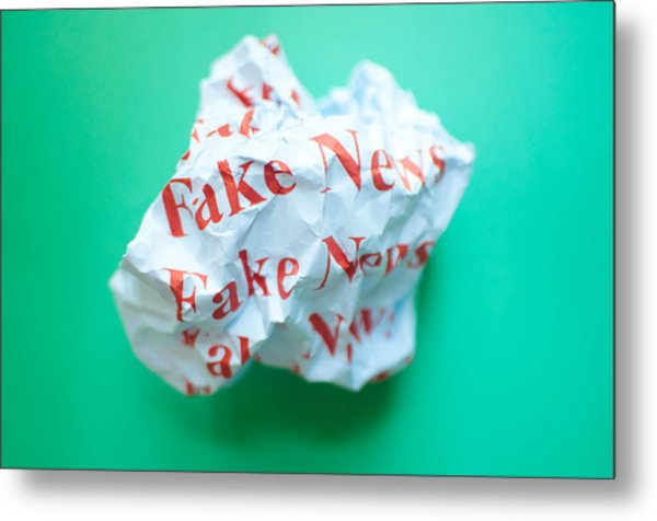 Fake News Against Blue Green Background Metal Print by Karl Tapales