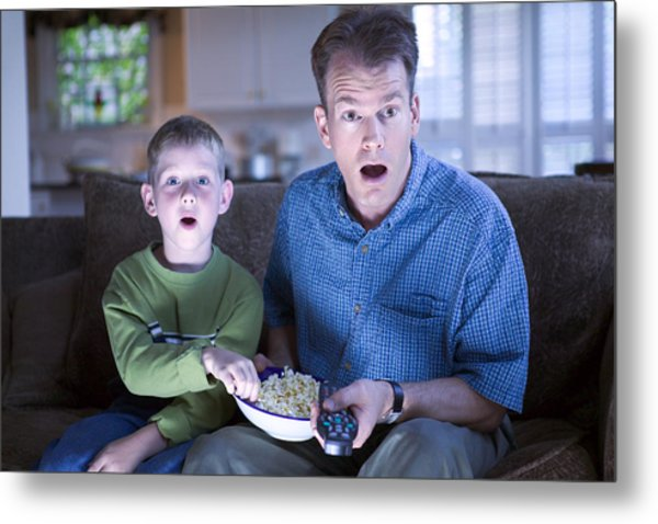 Father And Son With Remote Control And Popcorn Metal Print by Thinkstock Images