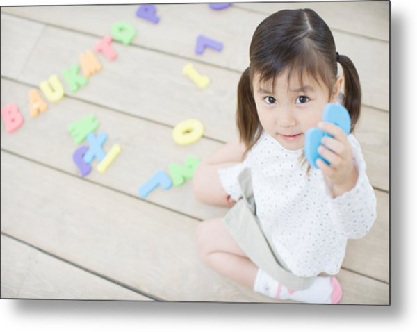 Female Toddler Playing With Educational Toys Metal Print by Image Source