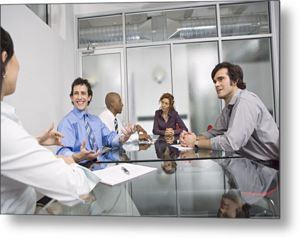 Five Businesspeople Sitting At Conference Table, Discussing Metal Print by Bob Handelman
