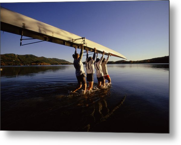 Four Young Women Carrying Canoe Into Lake Metal Print by Bob Handelman