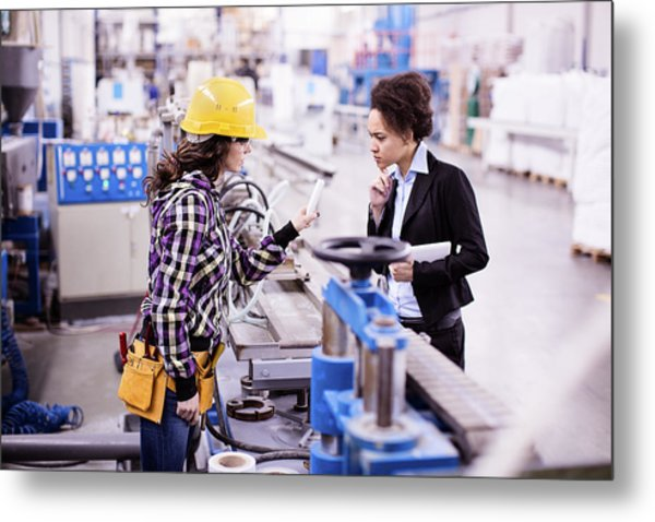 Girl In A Factory Working With Her Woman Boss Metal Print by Milanvirijevic