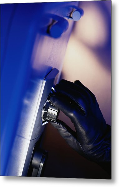 Gloved Hand Opening A Safe Metal Print by Photodisc