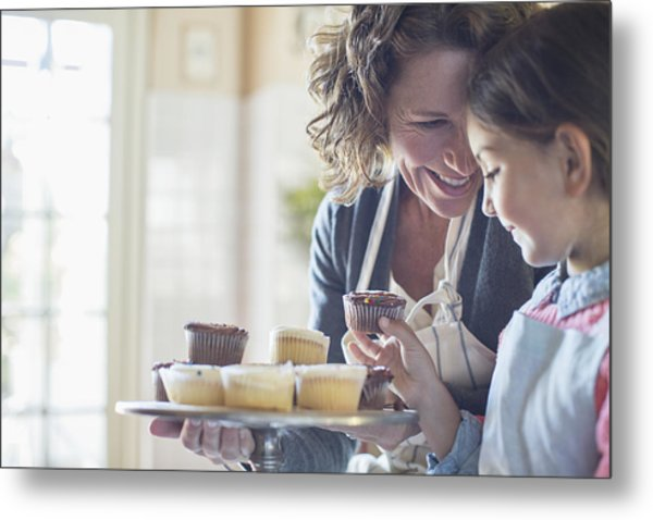 Grandmother Offering Granddaughter Cupcakes Metal Print by Caiaimage/Sam Edwards