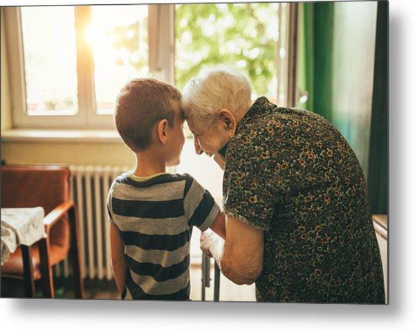 Grandson Visiting His Granny In Nursery Metal Print by Supersizer