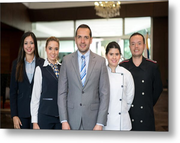 Happy Hotel Staff Metal Print by Andresr