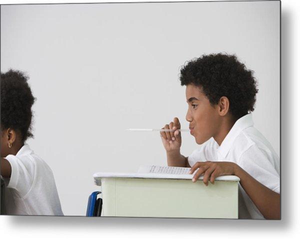 Hispanic Boy Blowing Spitball On Girl In Class Metal Print by Jose Luis Pelaez Inc