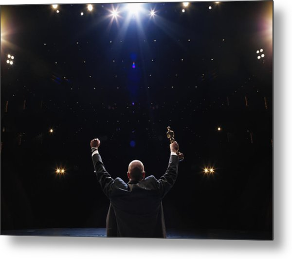 Man Holding Up Award Towards Audience, Rear View Metal Print by Thomas Barwick