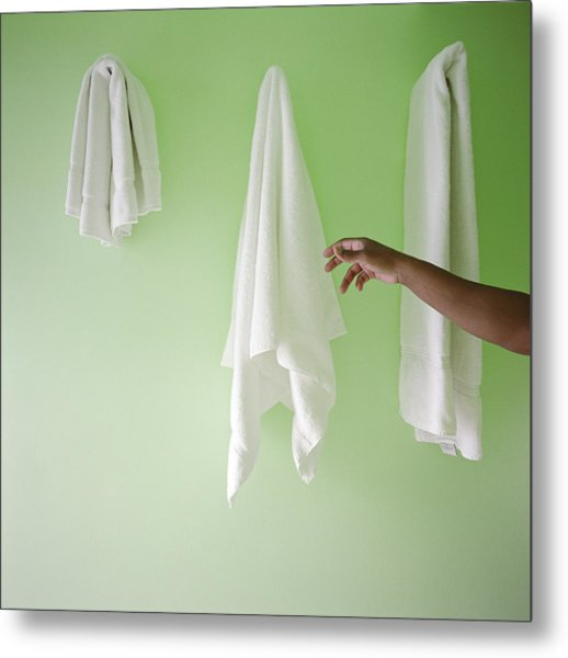 Man Reaching For Towel On Wall Metal Print by Candace Gottschalk