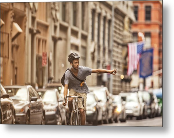 Man Riding Bicycle On City Street Metal Print by Sam Edwards