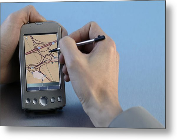 Man Using Gps System Metal Print by Comstock