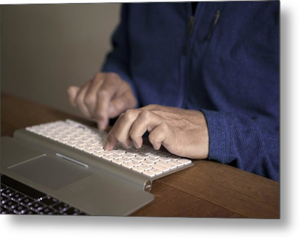 Midsection Of Man Typing On Keyboard At Table Metal Print by Paulien Tabak / EyeEm