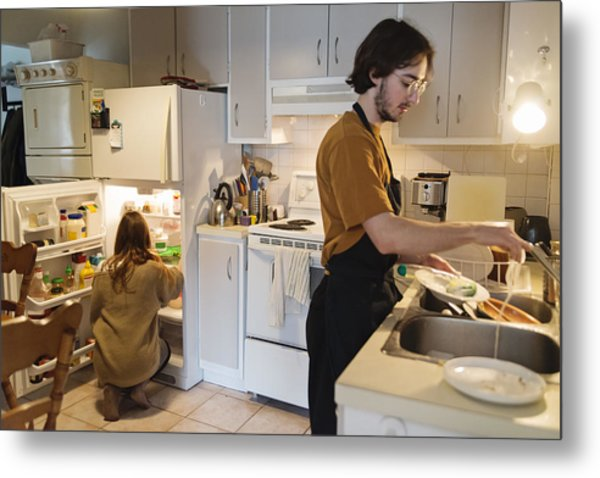 Millennial Couple Of Students Shared Living Doing Chores. Metal Print by Martinedoucet