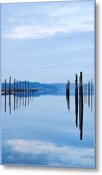 Pilings At Sea With Floating Docks Metal Print by Tom Reese, www.wowography.com