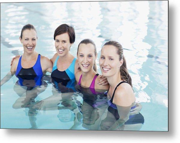 Portrait Of Smiling Women In Swimming Pool Metal Print by Robert Daly