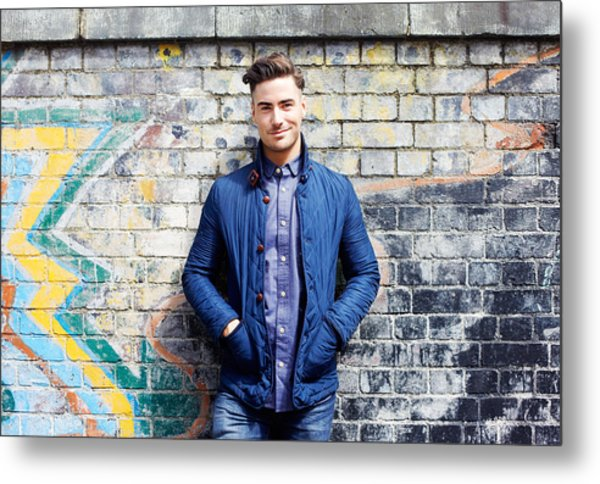 Portrait Of Young Man Against Wall. Metal Print by Tim Robberts