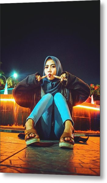 Portrait Of Young Woman Wearing Hijab While Sitting On Footpath At Night Metal Print by Ilham Adhi Kusuma / EyeEm