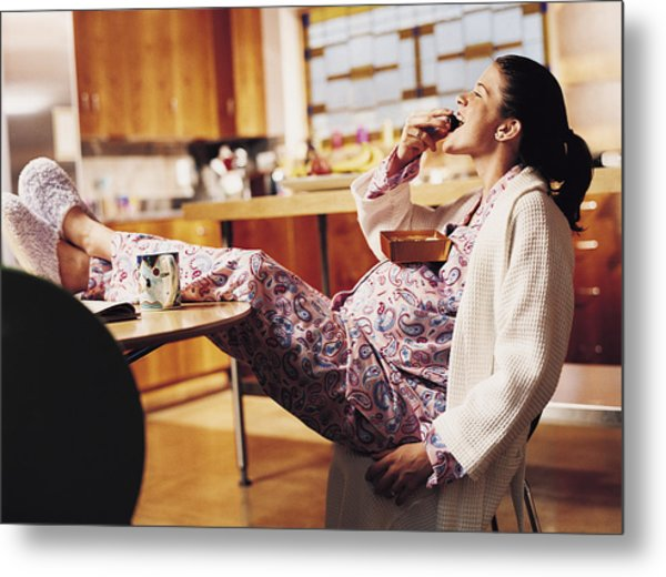 Pregnant Woman Eating Chocolate Metal Print by Cohen/Ostrow