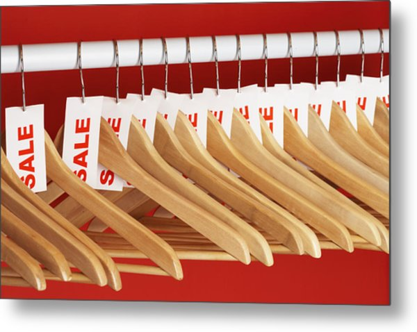 Rail Of Clothes Hangers With Sale Tags Attached, Close-up Metal Print by Martin Poole