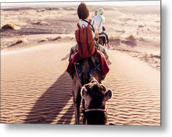 Rear View Of People Riding Camels In Desert Metal Print by Oscar Wong