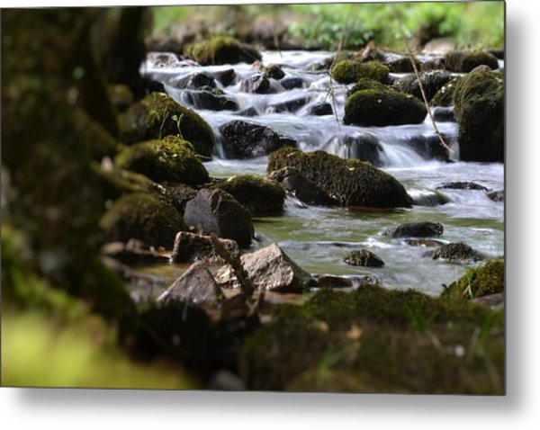 Rocks And The River Metal Print by Dave Woodbridge