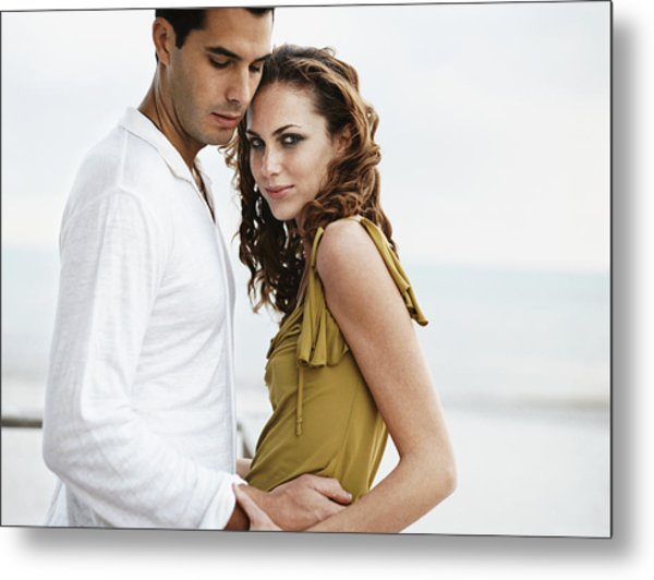 Romantic Couple Standing Together, Woman Looking At Camera Metal Print by Digital Vision.