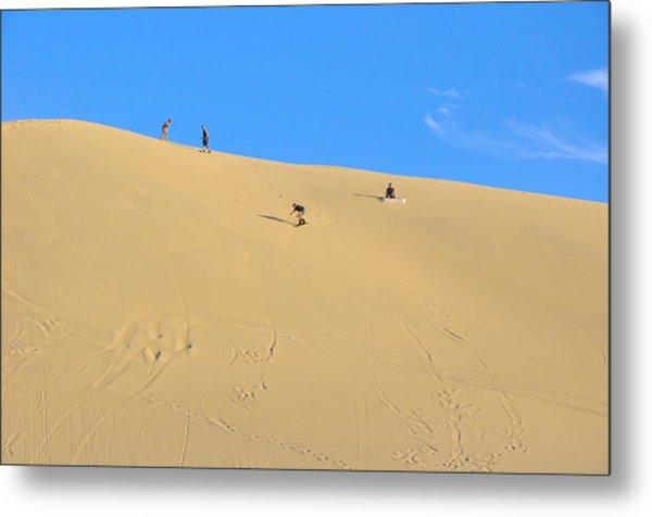 Sand Surfing In The Dunes Near Huacachina, Peru Metal Print by Markus Daniel