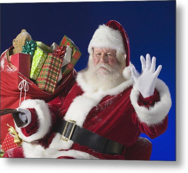 Santa Claus Next To Bag Of Toys Metal Print by Tetra Images