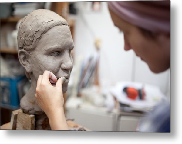 Sculptor Working On Head Sculpture Metal Print by Guido Mieth