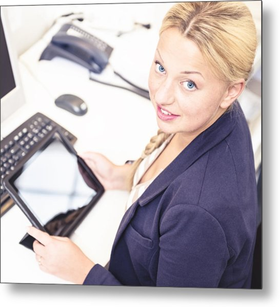 Secretary In Her Office Using A Digital Tablet Metal Print by Franckreporter