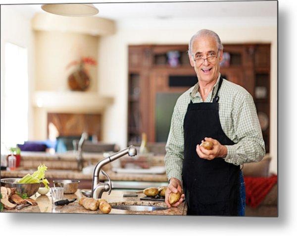 Senior Man Preparing To Wash Potatoes Metal Print by Lise Gagne