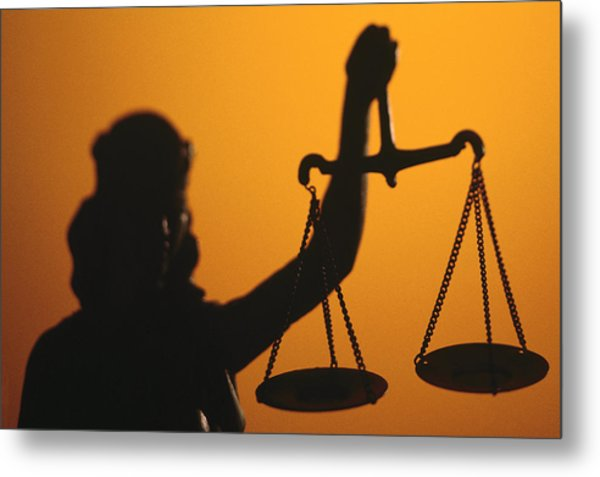 Silhouette Of Scales Of Lady Justice Holding Scales Metal Print by Comstock