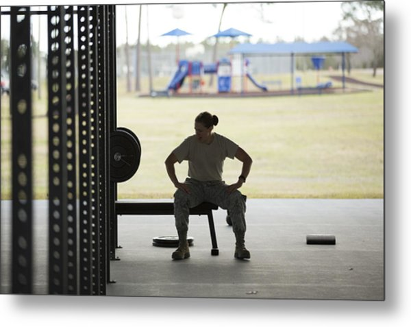 Silhouetted Female Soldier Barbell Training At Air Force Military Base Metal Print by Sean Murphy