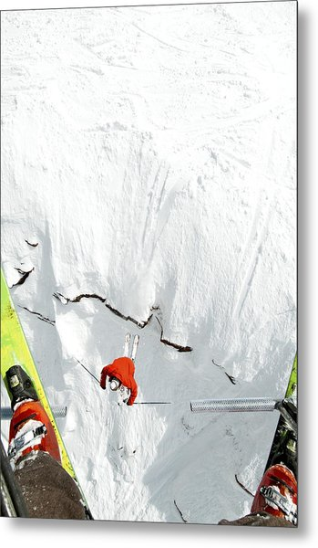 Skier Jumps Off Cliff Under Chairlift Metal Print by Connor Walberg