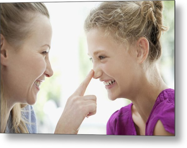 Smiling Mother Touching Daughters Nose Metal Print by Sam Edwards