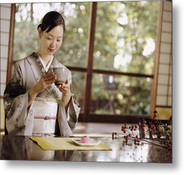 Smiling Woman Drinking Tea During A Japanese Tea Ceremony Metal Print by Digital Vision.