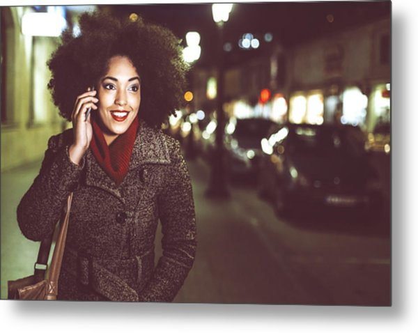 Smiling Young Woman Using Phone On Street By Night Metal Print by Portishead1